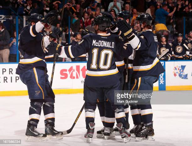 Andy McDonald of the St Louis Blues celebrates with teammates after scoring a goal in an NHL game against the Calgary Flames on April 25 2013 at...