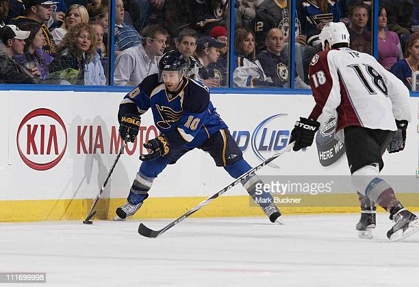 Andy McDonald of the St Louis Blues handles the puck as Brandon Yip of the Colorado Avalanche comes on to defend in an NHL game on April 5 2011 at...