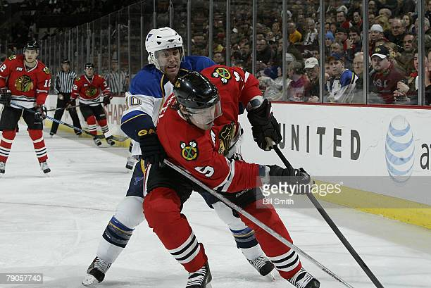 Andy McDonald of the St Louis Blues reaches his stick around Brent Sopel of the Chicago Blackhawks to make a steal on JANUARY 16 2007 at the United...