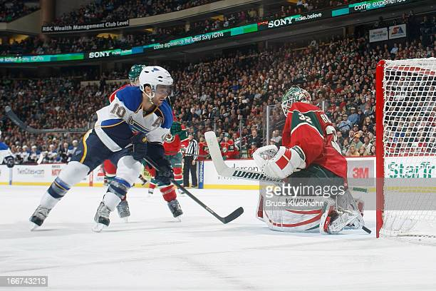 Andy McDonald of the St Louis Blues scores a goal against goalie Niklas Backstrom of the Minnesota Wild during the game on April 11 2013 at the Xcel...