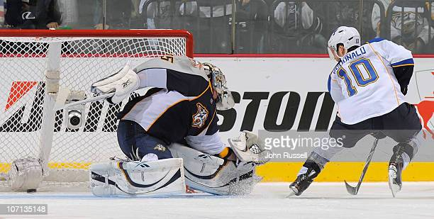 Andy McDonald of the St Louis Blues scores the overtime shootout game winner against Pekka Rinne of the Nashville Predators during an NHL game on...