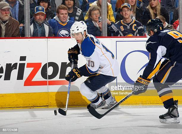 Andy McDonald of the StLouis Blues plays the puck near the sideboards during their NHL game against the Buffalo Sabres at HSBC Arena on November 12...