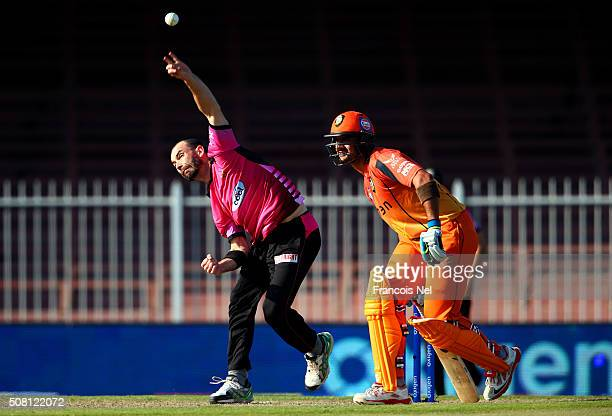 Andy McKay of Libra Legends bowls during the Oxigen Masters Champions League match between Libra Legends and Virgo Super Kings at Sharjah Cricket...
