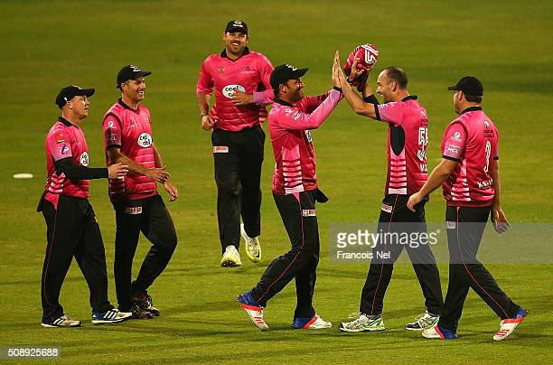 Andy McKay of Libra Legends celebrates the wicket of Hamish Marshall of Leo Lions with his teammates during the Oxigen Masters Champions League match...