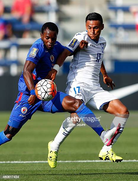 Andy Mejia#17 of Honduras battles Jean Sony Alcenat of Haiti for the ball during the 2015 CONCACAF Gold Cup match at Sporting Park on July 13 2015 in...