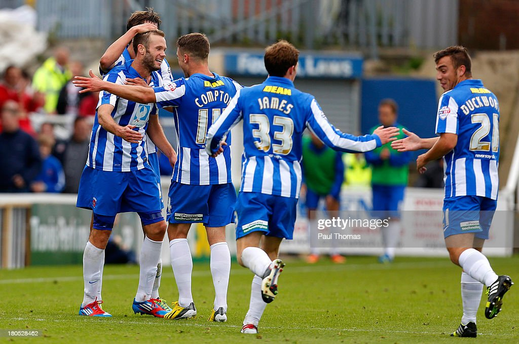 Andy Monkhouse (L) of Hartlepool celebrates his goal with team mates during the Sky Bet League Two match between Hartlepool United and Accrington Stanley at Victoria Park on September 14, 2013 in Hartlepool, England.