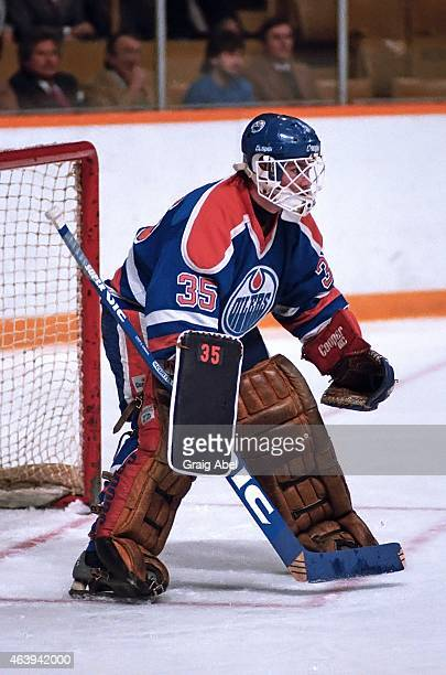 Andy Moog of the Edmonton Oilers prepares for a shot against the Toronto Maple Leafs during NHL game action at Maple Leaf Gardens in Toronto Ontario...