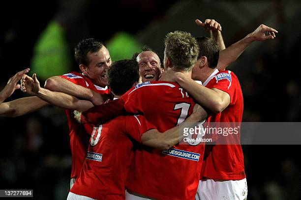 Andy Morrell of Wrexham is mobbed by his team mates after scoring the opening goal during the FA Cup Third Round Replay match between Wrexham and...