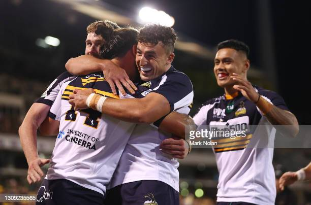 Andy Muirhead of the Brumbies is congratulated by team mates after scoing a try during the round 6 Super RugbyAU match between the ACT Brumbies and...