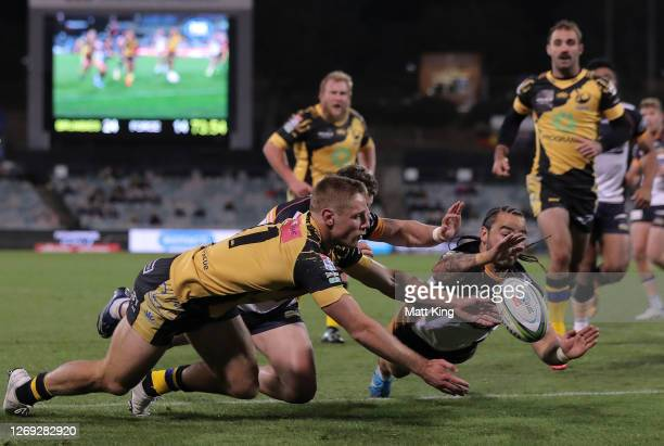 Andy Muirhead of the Brumbies scores a try during the round nine Super Rugby AU match between the Brumbies and the Western Force at GIO Stadium on...