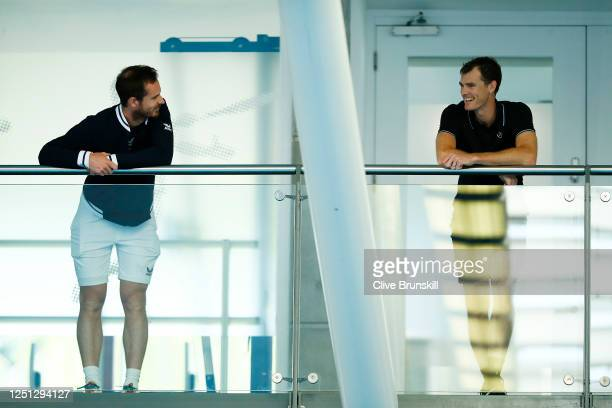 Andy Murray and brother Jamie Murray socially distance as they chat on the player's balcony during practice for the Schroders Battle of the Brits at...