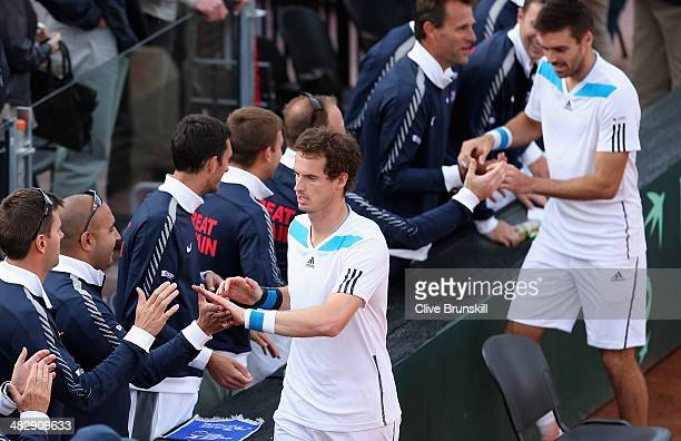 Andy Murray and Colin Fleming of Great Britain are congratulated by their team mates after their four set victory in the doubles third rubber against...