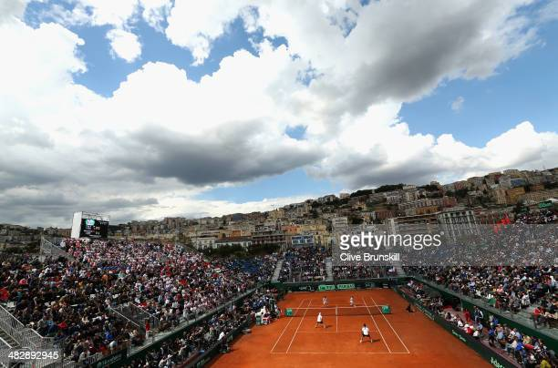 Andy Murray and Colin Fleming of Great Britain celebrate a point against Simone Bolelli and Fabio Fognini of Italy during day two of the Davis Cup...