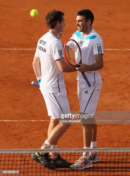 Andy Murray and Colin Fleming of Great Britain celebrate match point against Simone Bolelli and Fabio Fognini of Italy during day two of the Davis...
