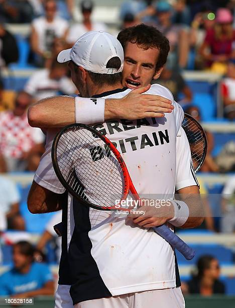 Andy Murray and Colin Fleming of Great Britain celebrate their win against Ivan Dodig and Mate Pavic of Croatia in the doubles during day two of the...