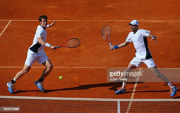 Andy Murray and Colin Fleming of Great Britain in action against Ivan Dodig and Mate Pavic of Croatia in the doubles during day two of the Davis Cup...