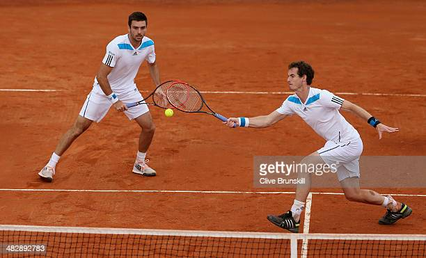 Andy Murray and Colin Fleming of Great Britain in action against Simone Bolelli and Fabio Fognini of Italy during day two of the Davis Cup World...