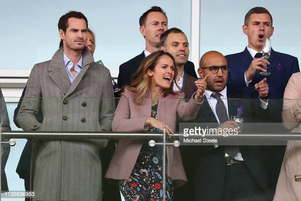 Andy Murray and his wife Kim Murray look on during the opening race on Ladies Day of the Cheltenham Festival at Cheltenham Racecourse on March 13...