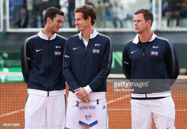 Andy Murray and James Ward of Great Britain share a joke prior to the opening ceremony and national anthems during day two of the Davis Cup World...