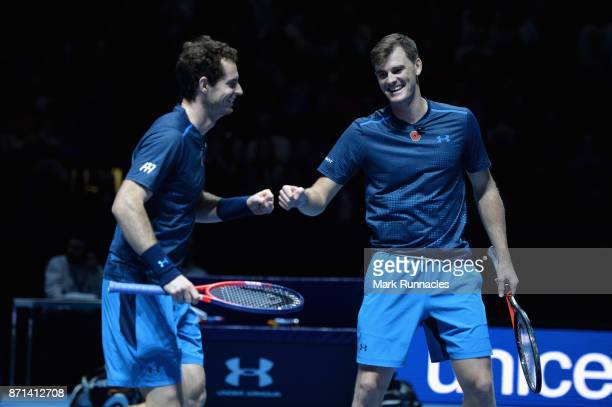 Andy Murray and Jamie Murray celebrate a point in their match against Tim Henman and Mansour Bahrami during Andy Murray Live at The Hydro on November...