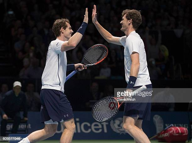 Andy Murray and Jamie Murray celebrates a point against Tim Henman and Grigor Dimitrov during Andy Murray Live presented by SSE at the SSE Hydro on...