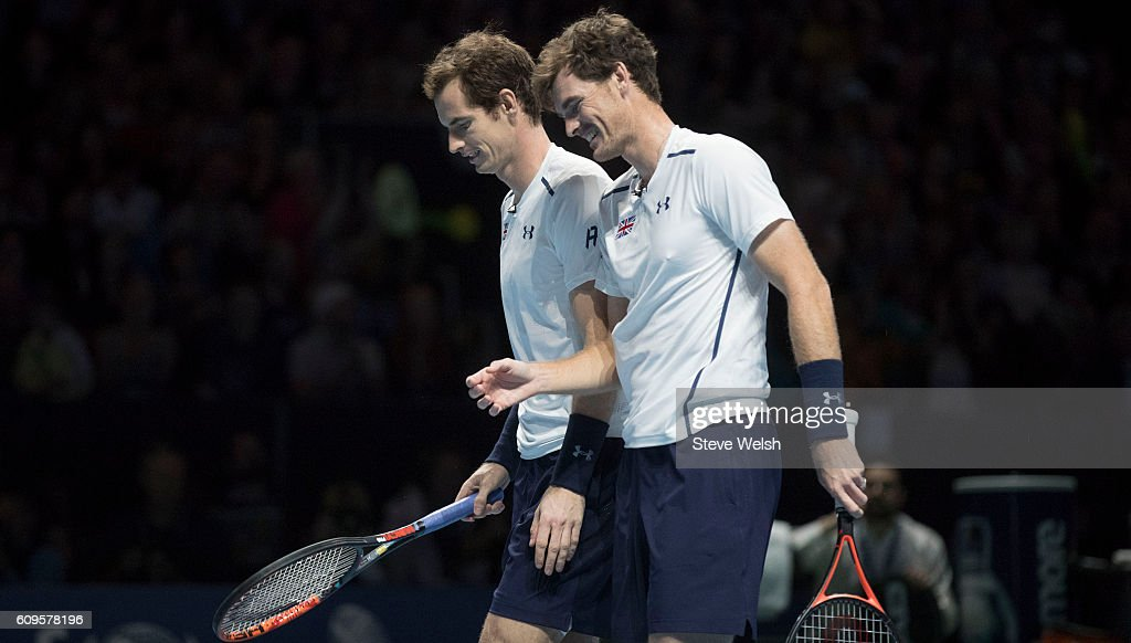 Andy Murray and Jamie Murray in doubles action against Grigor Dimitrov and Tim Henman during Andy Murray Live presented by SSE at the SSE Hydro on September 21, 2016 in Glasgow, Scotland.