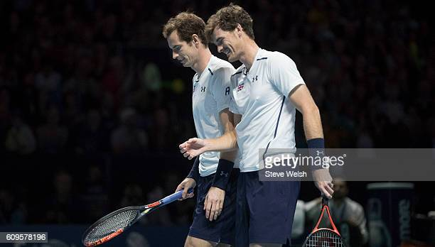 Andy Murray and Jamie Murray in doubles action against Grigor Dimitrov and Tim Henman during Andy Murray Live presented by SSE at the SSE Hydro on...