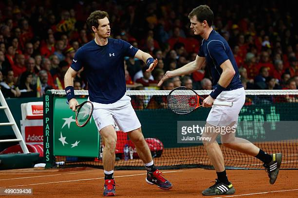 Andy Murray and Jamie Murray of Great Britain celebrate a point in the doubles match against David Goffin and Steve Darcis of Belgium on day two of...