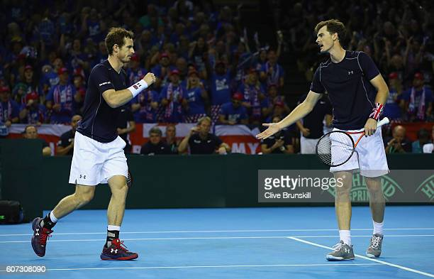 Andy Murray and Jamie Murray of Great Britain celebrate a point against Juan Martin Del Potro and Leonardo Mayer of Argentina in their doubles match...