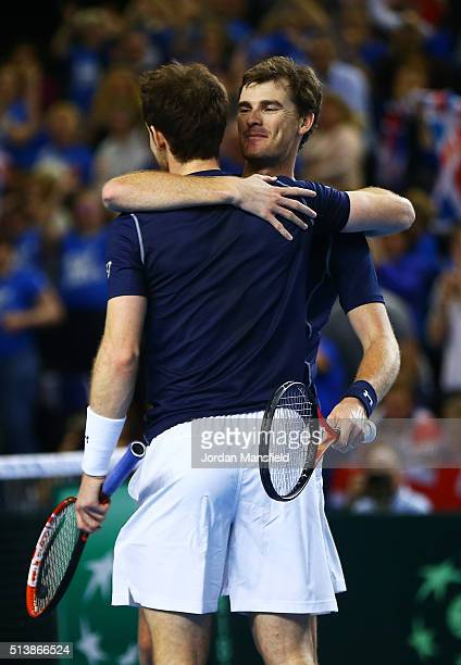 Andy Murray and Jamie Murray of Great Britain celebrate following their victory during the doubles match against Yoshihito Nishioka and Yasutaka...