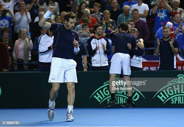 Andy Murray and Jamie Murray of Great Britain celebrate to their team bench and crowd after their straight sets victory in the doubles match against...