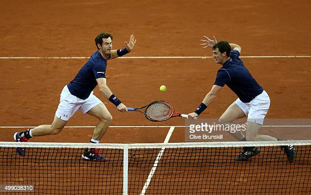 Andy Murray and Jamie Murray of Great Britain compete in the doubles match against David Goffin and Steve Darcis of Belgium on day two of the Davis...