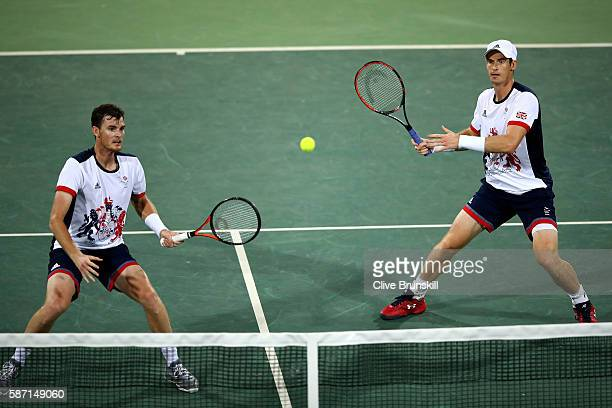 Andy Murray and Jamie Murray of Great Britain in action against Thomaz Bellucci and Andre Sa of Brazil in the mens doubles on Day 2 of the Rio 2016...