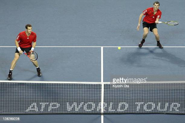 Andy Murray and Jamie Murray of Great Britain play in their quarter final doubles match against Tatsuma Ito and Kei Nishikori of Japan during day...