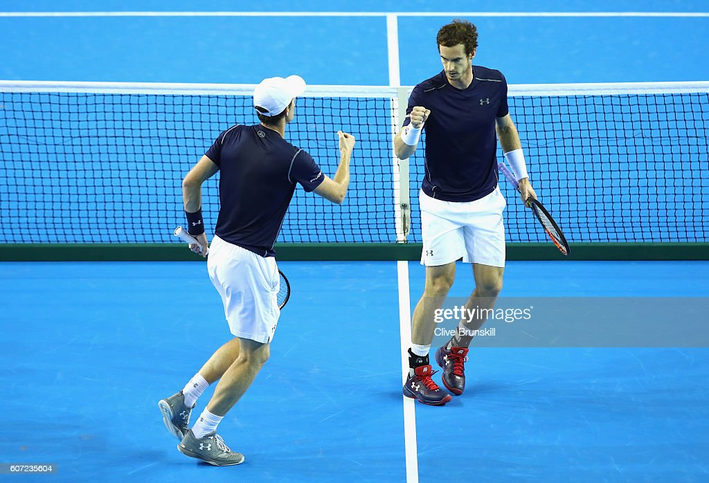 Andy Murray (R) and Jamie Murray of Great Britain react during the doubles match against Juan Martin del Potro and Leonardo Mayer of Argentina on day two of the Davis Cup Semi Final between Great Britain and Argentina at Emirates Arena on September 17, 2016 in Glasgow, Scotland.