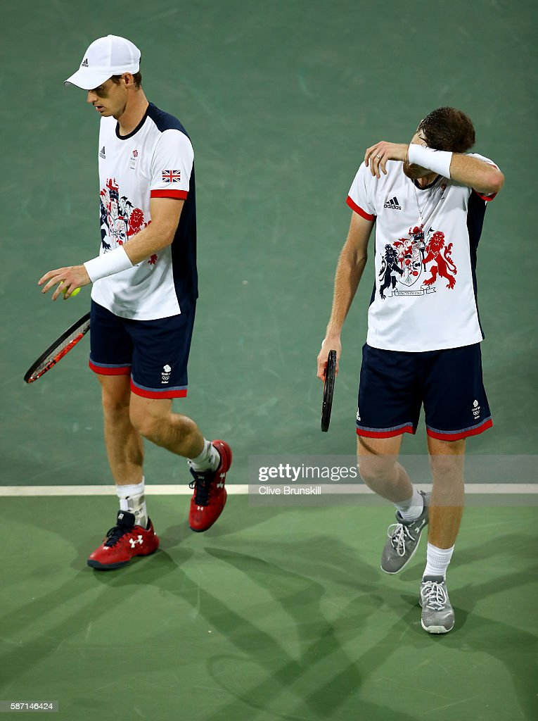 Andy Murray and Jamie Murray of Great Britain react during their defeat against Thomaz Bellucci and Andre Sa of Brazil in the mens doubles on Day 2 of the Rio 2016 Olympic Games at the Olympic Tennis Centre on August 7, 2016 in Rio de Janeiro, Brazil.
