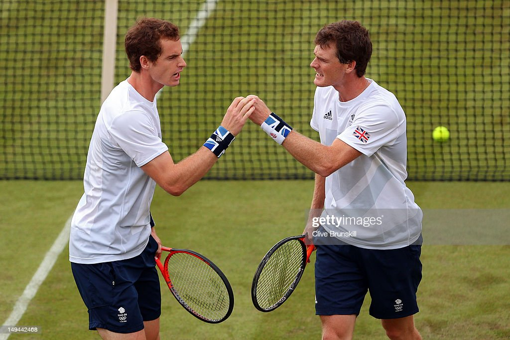 Andy Murray and Jamie Murray of Great Britain reacts after a point against Alexander Peya and Jurgen Melzer of Austria during their Men's Doubles Tennis match on Day 1 of the London 2012 Olympic Games at the All England Lawn Tennis and Croquet Club in Wimbledon on July 28, 2012 in London, England.