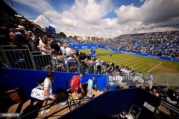 Andy Murray and Kyle Edmund of Great Britain make their way out to centre court ahead of their quarter final match on day five of The Aegon...