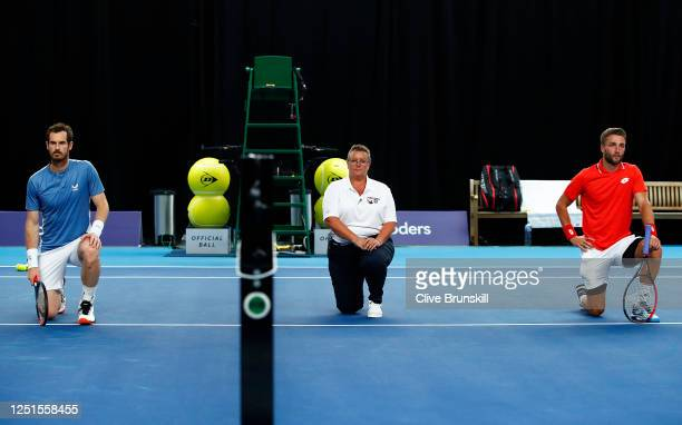 Andy Murray and Liam Broady take a knee in solidarity with the BLM movement ahead of the their match on day 1 of Schroders Battle of the Brits at the...