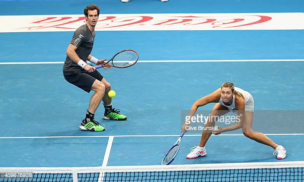 Andy Murray and Maria Sharapova of the Manila Mavericks in action against Kristina Mladenovic and Nenad Zimonjic of the UAE Royals during their...