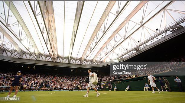 Andy Murray arrives onto Centre Court for his match against Tommy Robredo on Day 5 of the Wimbledon Lawn Tennis Championships at the All England Lawn...
