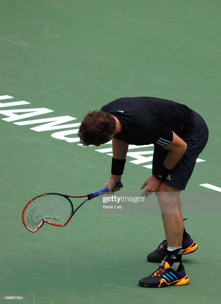 Andy Murray breaks his racket during his match against David Ferrer of Spain during day 5 of the Shanghai Rolex Masters at Zi Zhong stadium on October 9, 2014 in Shanghai, China. David Ferrer defeats Andy Murray by 2-6, 6-1, 6-2.
