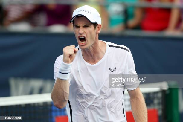 Andy Murray celebrates a shot while playing with his brother Jamie Murray of Great Britain during their doubles match against Raven Klaasen of Russia...