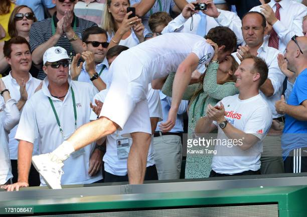 Andy Murray celebrates with girlfriend Kim Sears after beating Novak Djokovic in the Mens Singles Final on Day 13 of the Wimbledon Lawn Tennis...