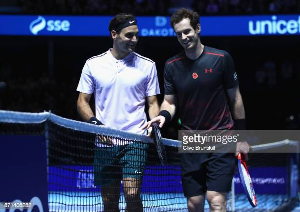 Andy Murray congratulates winner Roger Federer on victory following their match during Andy Murray Live at The Hydro on November 7 2017 in Glasgow...