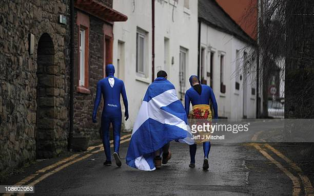 Andy Murray fans make their way home after watching his Australian Open final match against Novak Djokivic in the bar of The Dunblane Hotel in his...