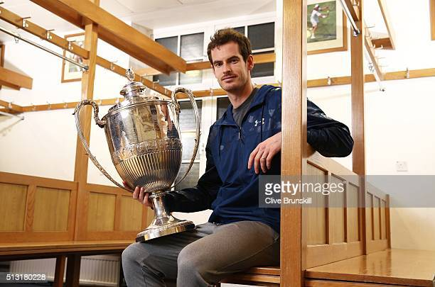 Andy Murray holds the Aegon Championships trophy at The Queens Club Dressing Rooms on February 26 2016 in LondonUnited Kingdom Which he will try to...