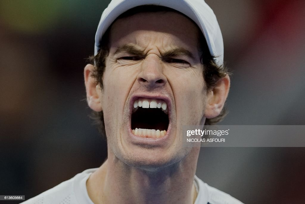 TOPSHOT - Andy Murray of Britain celebrates winning a point against Grigor Dimitrov of Bulgaria in their men's singles final match of the China Open tennis tournament in Beijing on October 9, 2016. / AFP / NICOLAS