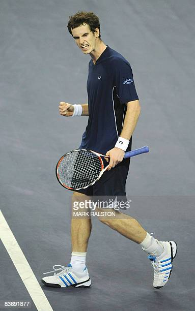 Andy Murray of Britain celebrates winning match point against Roger Federer of Switzerland in their men's singles match on the sixth day of the ATP...