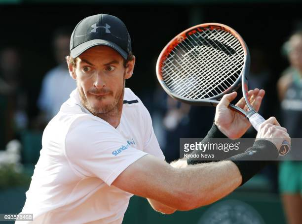 Andy Murray of Britain hits a backhand slice during his quarterfinal match against Kei Nishikori of Japan at the French Open in Paris on June 7 2017...